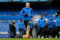 Aaron Mooy of Huddersfield Town warms up ahead of kick-off during Chelsea vs Huddersfield Town, Premier League Football at Stamford Bridge on 2nd February 2019