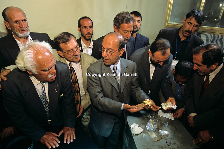 Viktor Sarianidi, meet with Sayed Raheen, Afghanistan's Minister of Culture, and other officials to inspect Bactrian gold found in safe of Presidential Palace, Kabul, Afghanistan.