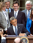 United States President Barack Obama signs the Jumpstart Our Business Startups (JOBS) Act in the Rose Garden of the White House in Washington, D.C. on Thursday, April 5, 2012.  This is a bipartisan act that incorporates the Presidents proposals to encourage startups and support our nations small businesses.  Looking on from left: unidentified; Steve Case; U.S. House Majority Leader Eric Cantor (Republican of Virginia); and U.S. Representative John B. Larson (Democrat of Connecticut)..Credit: Ron Sachs / CNP