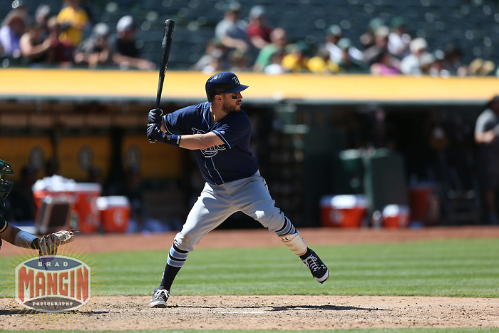 OAKLAND, CA - JULY 19:  revor Plouffe #14 of the Tampa Bay Rays bats against the Oakland Athletics during the game at the Oakland Coliseum on Wednesday, July 19, 2017 in Oakland, California. (Photo by Brad Mangin)