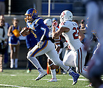 BROOKINGS, SD - NOVEMBER 12:  Taryn Christion #3 from South Dakota State University tries for extra yardage past Alex Gray #22 from the University of South Dakota in the first half at the Dana J. Dykhouse Stadium November 12, 2016 in Brookings, South Dakota. (Photo by Dave Eggen/Inertia)
