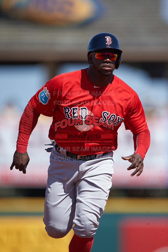 Boston Red Sox center fielder Rusney Castillo (38) running the bases during a Spring Training game against the Pittsburgh Pirates on March 9, 2016 at McKechnie Field in Bradenton, Florida.  Boston defeated Pittsburgh 6-2.  (Mike Janes/Four Seam Images)