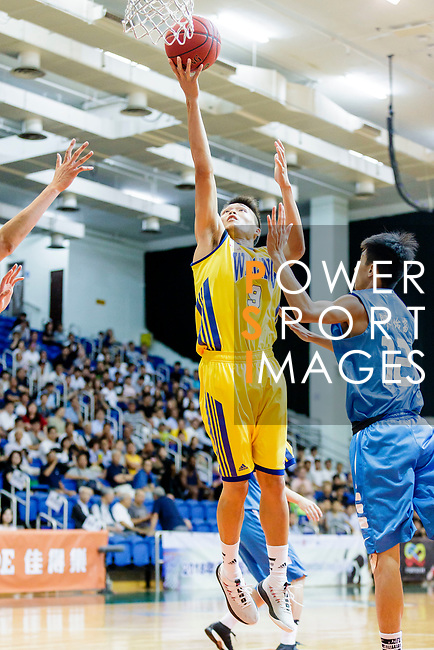 Fok Ka Ming #9 of Winling Basketball Club tries to score against the Fukien during the Hong Kong Basketball League game between Winling and Fukien at Southorn Stadium on May 29, 2018 in Hong Kong. Photo by Yu Chun Christopher Wong / Power Sport Images
