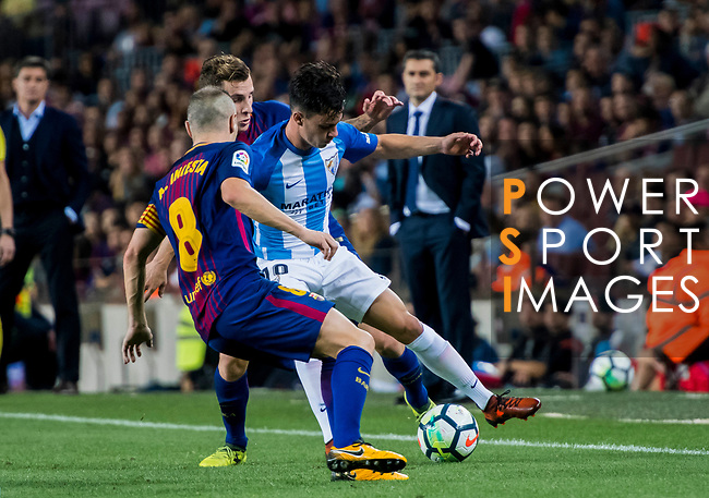 Juan Pablo Anor Acosta, Juanpi (r), of Malaga CF is tackled by Lucas Digne (c) and Andres Iniesta Lujan of FC Barcelona during the La Liga 2017-18 match between FC Barcelona and Malaga CF at Camp Nou on 21 October 2017 in Barcelona, Spain. Photo by Vicens Gimenez / Power Sport Images