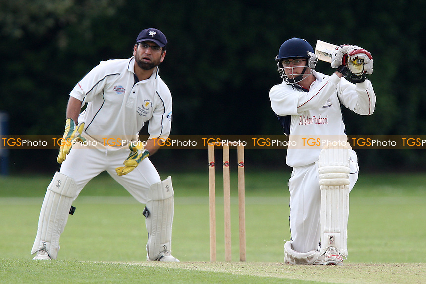 F Butt looks on as A D'Cruz scores four runs for Upminster - Upminster CC vs Ardleigh Green CC - National Club Championship 1st Round - 16/05/10 - MANDATORY CREDIT: Gavin Ellis/TGSPHOTO - Self billing applies where appropriate - Tel: 0845 094 6026