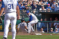 Chicago White Sox catcher Sandy Alomar Jr. makes it back to first in the seventh inning as the ball gets away from Royals first baseman Mike Sweeney at Kauffman Stadium in Kansas City, Missouri on April 2, 2003. Kansas City won 5-4.