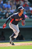 Center fielder Ray-Patrick Didder (11) of the Rome Braves runs toward first in a game against the Greenville Drive on Sunday, July 31, 2016, at Fluor Field at the West End in Greenville, South Carolina. Rome won, 6-3. (Tom Priddy/Four Seam Images)
