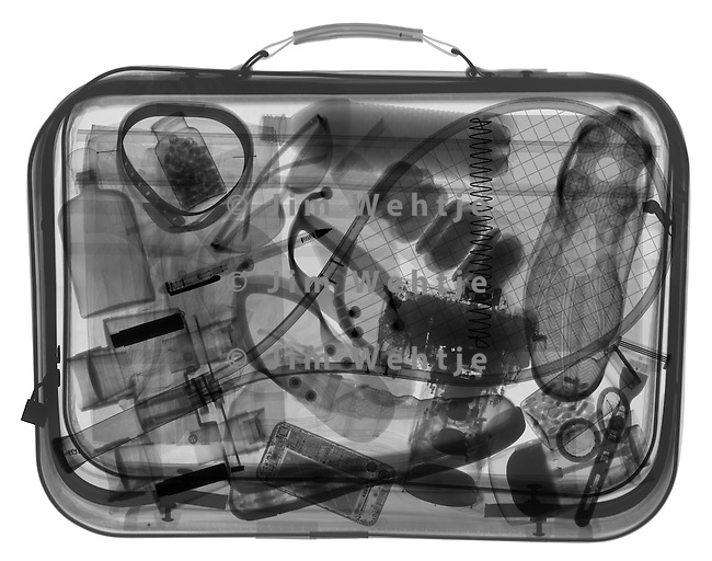X-ray image of a man's suitcase (black on white) by Jim Wehtje, specialist in x-ray art and design images.