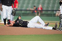 Kannapolis Intimidators starting pitcher Yelmison Peralta (33) lies on the ground in pain after having been hit in the ankle with a line drive during the game against the Hagerstown Suns at CMC-Northeast Stadium on July 19, 2015 in Kannapolis, North Carolina.  The Suns defeated the Intimidators 9-4.  (Brian Westerholt/Four Seam Images)