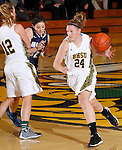 SPEARFISH, SD - DECEMBER 15, 2013:  Courtney Patterson #24 of Black Hills State drives past Catherine Jiminez #32 of Colorado Mines during their Rocky Mountain Athletic Conference game Sunday at the Donald E. Young Center in Spearfish, S.D. (Photo by Dick Carlson/Inertia)