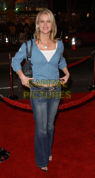 MAEVE QUINLAN.Universal Pictures World Premiere of Along Came Polly held at the Grauman's Chinese Theater .*UK Sales Only*.12 January 2004.full length, full-length, denim jeans, blue hooded cardigan.www.capitalpictures.com.sales@capitalpictures.com.©Capital Pictures.