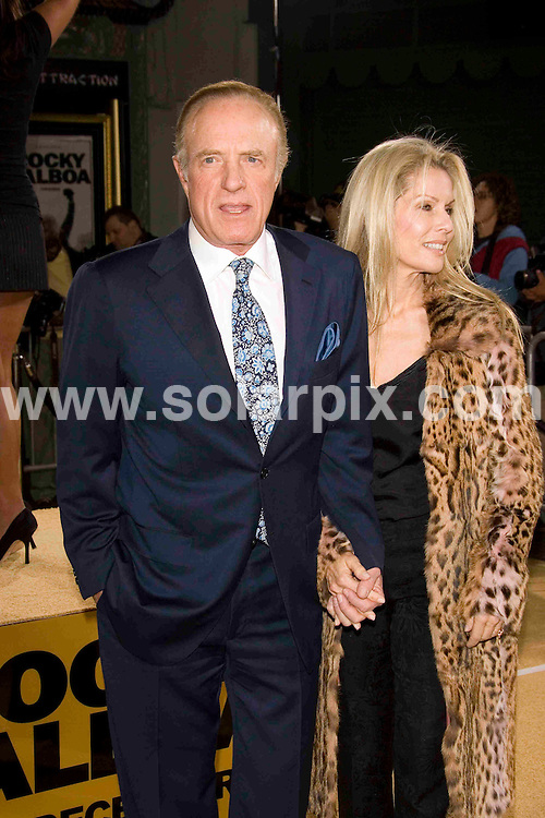ALL ROUND PICTURES FROM SOLARPIX.COM SYNDICATION RIGHTS FOR UK, SOUTH AFRICA, DUBAI, AUSTRALIA..James Caan and wife arrive at the premiere of the film, ROCKY BALBOA in Hollywood, Ca. at Grauman's Chinese Theater on Dec 13, 2006...DATE: 13/12/2006-JOB REF: 3164-PHZ.**MUST CREDIT SOLARPIX.COM OR DOUBLE FEE WILL BE CHARGED**