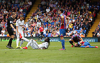 Pictured: Kenji Gorre of Swansea helps team mate Marvin Emnes with his cramp<br />
