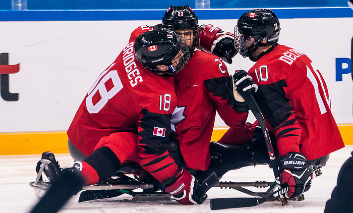 PyeongChang 15/3/2018 - Goal celebration as Canada takes on Korea in semifinal hockey action at the Gangneung Hockey Centre during the 2018 Winter Paralympic Games in Pyeongchang, Korea. Photo: Dave Holland/Canadian Paralympic Committee