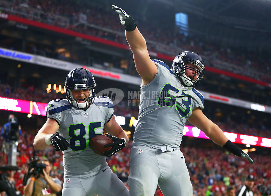 Jan 3, 2016; Glendale, AZ, USA; Seattle Seahawks tight end Chase Coffman (left) celebrates a touchdown in the second quarter with guard Mark Glowinski against the Arizona Cardinals at University of Phoenix Stadium. Mandatory Credit: Mark J. Rebilas-USA TODAY Sports