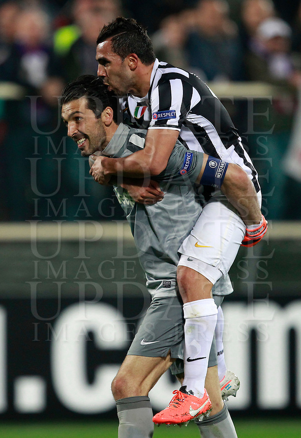 Calcio, ritorno degli ottavi di finale di Europa League: Fiorentina vs Juventus. Firenze, stadio Artemio Franchi, 20 marzo 2014. <br /> Juventus goalkeeper Gianluigi Buffon, left, and forward Carlos Tevez, of Argentina, celebrate at the end of the Europa League round of 16 second leg football match between Fiorentina and Juventus at Florence's Artemio Franchi stadium, 20 March 2014. Juventus won 1-0 to advance to the quarter-finals.<br /> UPDATE IMAGES PRESS/Isabella Bonotto