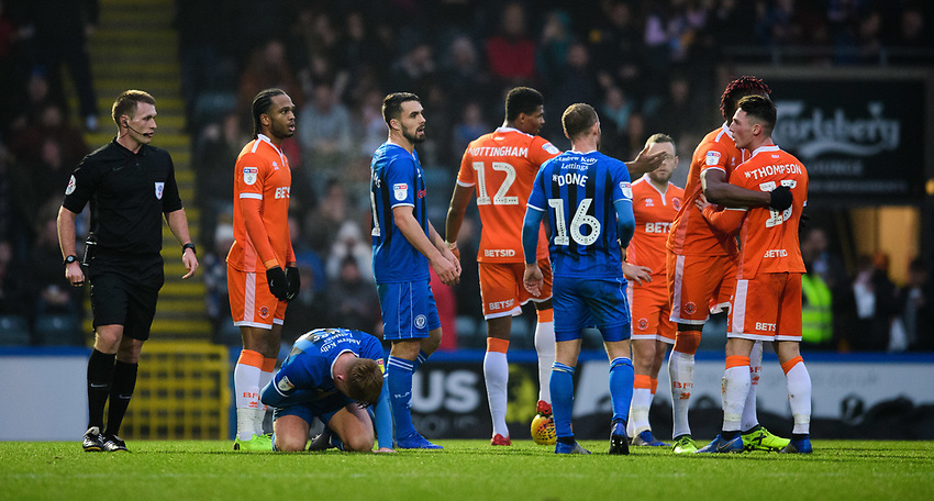 Blackpool's Jordan Thompson, right, reacts after he was shown a red card by referee Thomas Bramall<br /> <br /> Photographer Chris Vaughan/CameraSport<br /> <br /> The EFL Sky Bet League One - Rochdale v Blackpool - Wednesday 26th December 2018 - Spotland Stadium - Rochdale<br /> <br /> World Copyright © 2018 CameraSport. All rights reserved. 43 Linden Ave. Countesthorpe. Leicester. England. LE8 5PG - Tel: +44 (0) 116 277 4147 - admin@camerasport.com - www.camerasport.com