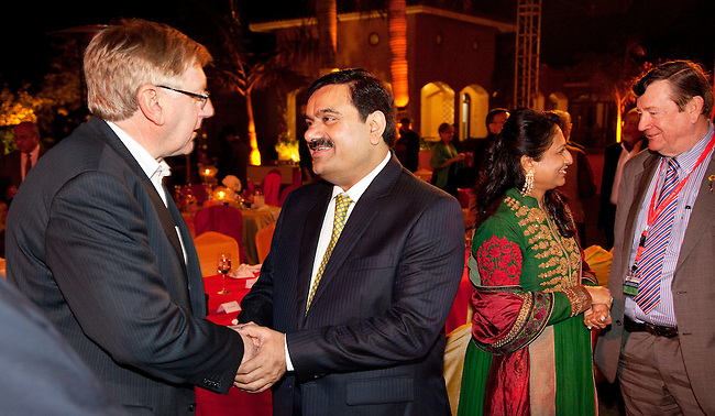 2 December 2012, Mundra, Gujurat, INDIA:  Federal Minister for Resources and Energy, Martin Ferguson thanks Indian businessman Gautam Adani at his home on a visit to Gujurat. Guests were treated to a performance of Queensland orchestra act Deep Blue at a private concert at the home of Mr. Adani. Deep Blue are in India as part of Oz Fest.   Picture by Graham Couch/DFAT
