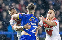 Picture by Allan McKenzie/SWpix.com - 09/03/2018 - Rugby League - Betfred Super League - Warrington Wolves v St Helens - Halliwell Jones Stadium, Warrington, England - Joe Philbin fends off Dominique Peyroux and James Roby.