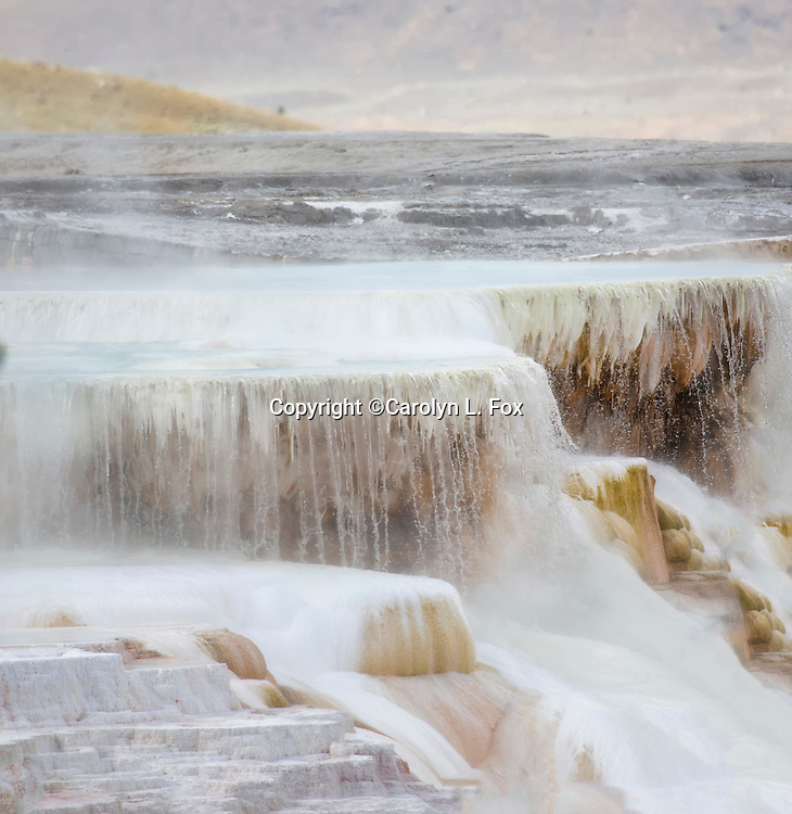 Water pours over geological structures at Mammoth Hot Springs in Yellowstone National Park.
