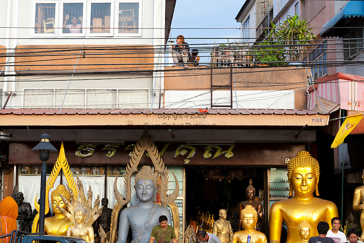 Bum Rung Muang Rd., near Wat Suthat, that is lined with shops that sell statues of Buddha and other religious icons.