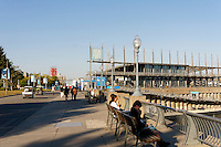 People on the Promenade des Artistes with Jacques Cartier Pavillion in the Old Port of Montreal, Quebec, Canada