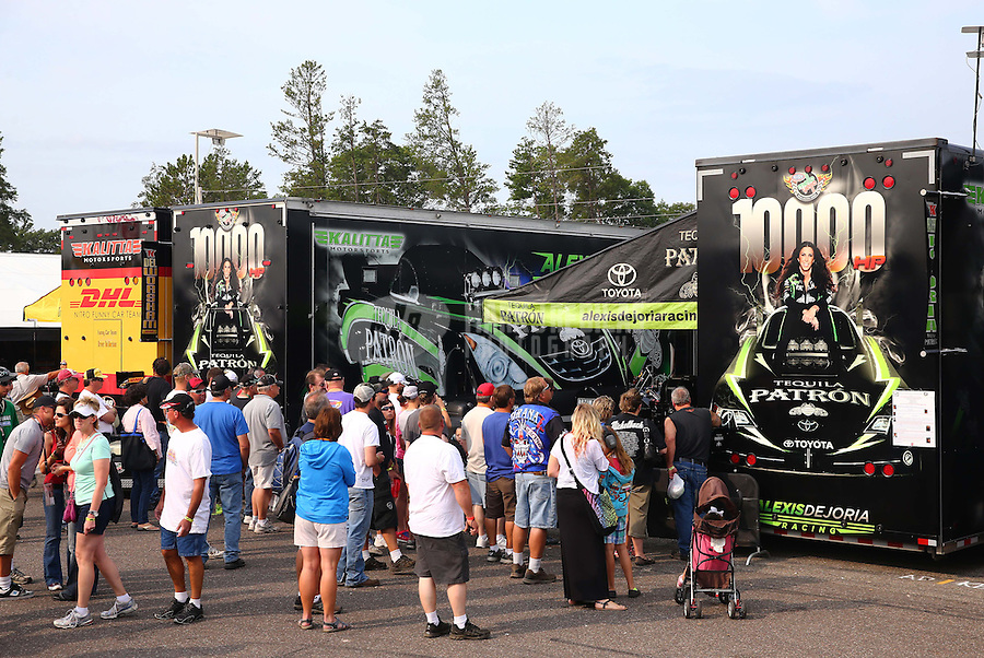 Aug. 18, 2013; Brainerd, MN, USA: Fans gather behind the pits of NHRA funny car driver Alexis DeJoria during the Lucas Oil Nationals at Brainerd International Raceway. Mandatory Credit: Mark J. Rebilas-
