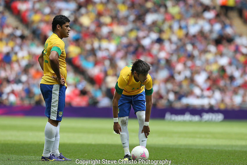 Brazil's Neymar da Silva Santos Junior and  teammate Givanildo Vieira de Souza or Hulk wait to take a free kick during play against Mexico in the gold medal match at Wembley Stadium, London, UK. Saturday 11th August 2012. (Photo: Steve Christo)