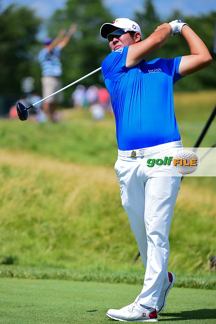 Byeong Hun An (KOR) watches his tee shot on 12 during Thursday's round 1 of the 117th U.S. Open, at Erin Hills, Erin, Wisconsin. 6/15/2017.<br /> Picture: Golffile   Ken Murray<br /> <br /> <br /> All photo usage must carry mandatory copyright credit (&copy; Golffile   Ken Murray)