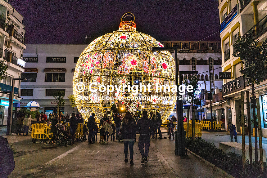 Christmas Lights, San Pedro de Alcantara, Malaga Province, Spain, November, 2018, 201811300056<br /> <br /> Copyright Image from Victor Patterson, Belfast, UK, BT9 5HG<br /> <br /> t: +44 28 9066 1296 (from Rep of Ireland 048 9066 1296)<br /> m: +44 7802 353836<br /> <br /> victorpattersonbelfast@gmail.com<br /> www.victorpatterson.com<br /> <br /> Please see my Terms and Conditions of Use at https://www.victorpatterson.com/page2<br /> It is IMPORTANT that you familiarise yourself with them.<br /> <br /> Images used on the Internet incur an additional cost and must be visibly watermarked i.e. © Victor Patterson within the body of the image and copyright metadata must not be deleted. Images used on the Internet have a size restriction of 4kbs and are chargeable at rates available at victorpatterson.com.<br /> <br /> This image is only available for the use of the download recipient i.e. television station, newspaper, magazine, book publisher, etc, and must not be passed on to any third party. It is also downloaded on condition that each and every usage is notified within 7 days to victorpattersonbelfast@gmail.com.<br /> <br /> The right of Victor Patterson to be identified as the author is asserted in accordance with The Copyright Designs And Patents Act (1988). All moral rights are asserted.
