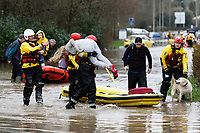Pictured: Residents being evacuated by the fire service in Nantgarw, Wales, UK. Sunday 16 February 2020<br /> Re: Residents from Oxford Street in the village of Nantgarw had to be evacuated in inflatable boats by the Fire Service after rover Taff burst its banks in south Wales, UK.