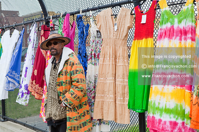A Vendor selling colourful cloths is seen on an highway overpass at the Detroit Eastern Farmers market in Detroit (Mi) Saturday June 8, 2013. The largest open-air flowerbed market in the United States, the Eastern Market is a historic commercial district in Detroit, Michigan.