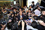 June 10th, 2011, Tokyo, Japan - Executive Vice President Satoshi Ozawa of Toyota Motor Corp. answers questions as he is surrounded by reporters after a news conference at its Tokyo head office on Friday, June 10, 2011. Toyota forecasts its annual profit to dive 31%  due to impact of strong yen and the March 11 earthquake and tsunami. The auto maker expects to post a net profit of 280 billion in the fiscal year ending March 2012, down 31% from 408.1 billion in the last fiscal year. (Photo by Natsuki Sakai/AFLO) [3615]