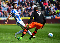 Huddersfield Town's Tommy Smith lays the ball off, under pressure from Sheffield Wednesday's Adam Reach<br /> <br /> Photographer Andrew Vaughan/CameraSport<br /> <br /> The EFL Sky Bet Championship Play-Off Semi Final First Leg - Huddersfield Town v Sheffield Wednesday - Saturday 13th May 2017 - The John Smith's Stadium - Huddersfield<br /> <br /> World Copyright &copy; 2017 CameraSport. All rights reserved. 43 Linden Ave. Countesthorpe. Leicester. England. LE8 5PG - Tel: +44 (0) 116 277 4147 - admin@camerasport.com - www.camerasport.com