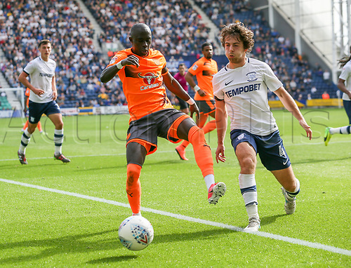 19th August 2017, Deepdale, Preston, England; EFL Championship league football, Preston North End versus Reading; Modou Barrow of Reading Ben Pearson of Preston North End battle for the ball