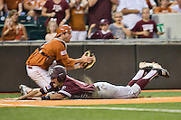 Texas A&M Aggies shortstop Kenny Jackson #15 slides headfirst into home against the Texas Longhorns in NCAA Big XII Conference baseball on May 21, 2011 at Disch Falk Field in Austin, Texas. (Photo by Andrew Woolley / Four Seam Images)