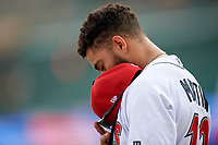 Indianapolis Indians Jason Martin (12) during the national anthem before an International League game against the Syracuse Mets on July 17, 2019 at Victory Field in Indianapolis, Indiana.  Syracuse defeated Indianapolis 15-5  (Mike Janes/Four Seam Images)