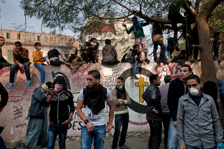 Protesters, some of them children, stand on Mohamed Mahmoud Street near Tahrir Square in Cairo, Egypt, Tuesday, November 22, 2011. Clashes between Central Security Forces and demonstrators demanding an end to military rule continued into a fourth day.