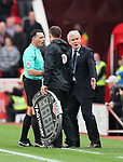 Stoke's Mark Hughes has words with referee Neil Swarbrick during the premier league match at the Britannia Stadium, Stoke on Trent. Picture date 9th September 2017. Picture credit should read: David Klein/Sportimage