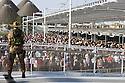 A soldier on the service of surveillance at the entrance to Expo 2015, Rho-Pero, Milan, Friday, June 26, 2015. Already at 6.30 pm begins to form the queue of visitors who will enter to Expo 2015 after 7.00 pm to take advantage of reduced-price tickets; the night ticket price is &euro; 5.00 against &euro; 39.00 for a full day. &copy; Carlo Cerchioli<br /> <br /> Un soldato in servizio di sorveglianza all'ingresso di Expo 2015, Rho-Pero, Milano, Venerd&igrave;, 26 giugno 2015. Gi&agrave; alle 18,30 inizia a formarsi la coda dei visitatori che entreranno a Expo 2015 dopo le ore 19,00  per usufruire del biglietto a prezzo ridotto; il prezzo del biglietto serale &egrave; di &euro; 5,00 contro &euro; 39,00 per l'intera giornata.