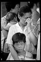 A mainland Chinese woman sobs with her son during a rally in Central financial district demanding the right of abode in Hong Kong, 1985. She was one of hundreds of mainlanders married to Hong Kong fishermen and lived illegally on their fishing boats.