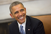 United States President Barack Obama smiles while meeting with President Francois Hollande of France in the Oval Office of the White House in Washington, D.C., U.S., on Tuesday, Feb. 11, 2014. <br /> Credit: Andrew Harrer / Pool via CNP