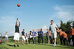 Yao Ming (right) and Allen Iverson (left) play basketball at the 17th hole during the World Celebrity Pro-Am 2016 Mission Hills China Golf Tournament on 22 October 2016, in Haikou, China. Photo by Weixiang Lim / Power Sport Images