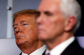 United States President Donald J. Trump listens during a news conference at the White House in Washington D.C., U.S. on Monday, April 20, 2020. <br /> Credit: Tasos Katopodis / Pool via CNP