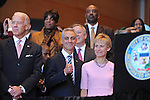 (L-R) Vice-President Joe Biden, Chicago Mayor Elect Rahm Emanuel and his wife Amy Rule stand on the stage at Emanuel's inauguration ceremony in Millennium Park in Chicago, Illinois on May 16, 2011.