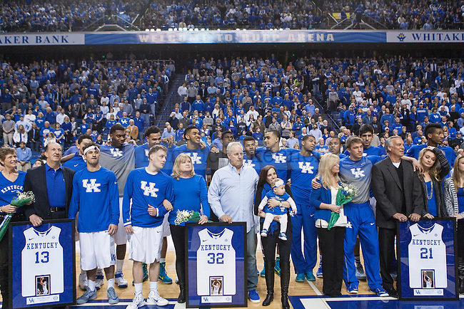 """Seniors Brian Long, Sam Malone, and Tod Lanter and their families sing """"My Old Kentucky Home"""" prior to the Florida Gators at Rupp Arena on Saturday, March 7, 2015 in Lexington, Ky. Kentucky leads Florida 30-27 at the half. Photo by Michael Reaves 