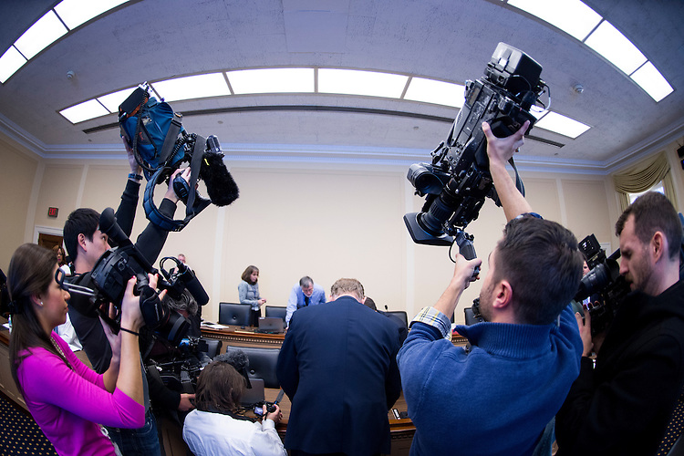 UNITED STATES - NOVEMBER 19: Cameras surround staff as they organize the numbered chips before the start of the room lottery draw and selection for the incoming members of the 114th Congress on Wednesday, Nov. 19, 2014. (Photo By Bill Clark/CQ Roll Call)