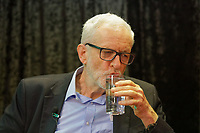 Pictured: Jeremy Corbyn drinks a glass of water at Barry Island Sports and Social Club. Saturday 07 December 2019<br /> Re: Labour Party leader Jeremy Corbyn pre-election campaign in Barry, south Wales, UK.