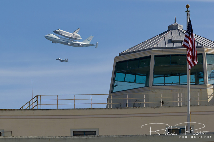 Space Shuttle Endeavour with its 747 escort flies over the tower on Treasure Island in San Francisco Bay during the spacecrafts final flight to Southern California.