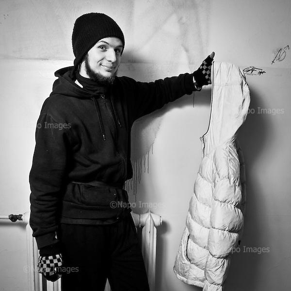 """WARSAW, POLAND, MARCH 2012:.Young man who lives at the squat in central Warsaw poses with the clothing item that is a part of """"freeshop"""" collection. The Freeshop is a place where people can leave unwanted clothes, while others can pick what they like for free. .(Photo by Piotr Malecki / Napo Images)..Warszawa Marzec 2012:.Zdjecie zrobione we """"freeshopie"""", czyli miejscu, gdzie mozna otrzymac za darmo niepotrzebne komus ubrania. Ten freeshop dziala w squacie """"Przychodnia"""" w centrum Warszawy, a od zdjec pozuje jeden ze studentow, ktorzy tu mieszkaja i prowadza ten """"sklep"""".Fot: Piotr Malecki / Napo Images"""